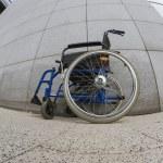 Abandoned wheelchair front facade — Stock Photo #27823719