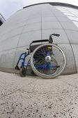 Abandoned wheelchair front facade — Stock Photo