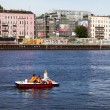 Young women drive pedal boat on the Spree River in Berlin Mitte — Stock Photo