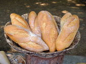 Fresh French bread in a basket — Stock Photo