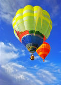 Balloons in blue sky — Stock Photo