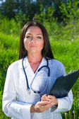 Attractive female doctor outdoors — Stock Photo