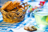 Green tea with cakes — Stock Photo