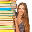 Happy girl with stack color books — 图库照片