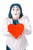 Sad female mime clown with a red heart — Stock Photo