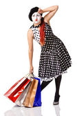 Tired mime in spotty dress holding shopping bags — Stock Photo