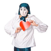 A sad female mime clown with a red heart — Stock Photo