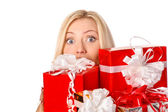 Attractive woman with gift boxes — Stock Photo