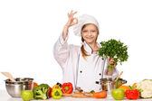 Happy little chef girl with hat holding parsley and showing OK s — Stock Photo