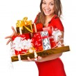 Stock Photo: Pretty girl in red dres holding behind the Christmas presents
