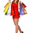 Lovely woman with shopping bags and discount or membership cards — Stock Photo