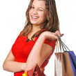Portrait of stunning young woman carrying shopping bags — Stock Photo