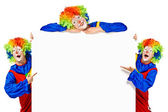 Set of three funny clown standing over a white background — Stock Photo