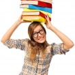 Student girl struggling with stack of books - Stock Photo
