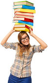 Student girl struggling with stack of books — Stock Photo