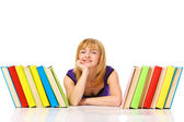 Young woman with stack of books — Stock Photo