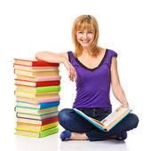 Mooie student met een stapel boeken — Stockfoto