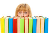 Surprised girl with stack color books. Isolated — Stok fotoğraf