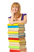 Studentka s hromady barevné knihy. samostatný — Stock fotografie