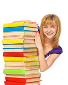 Happy girl with stack color books. Isolated — Stock Photo