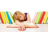 Tired of studies, young Woman is sleeping on her desk with books — Stock Photo