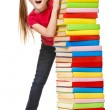 Stock Photo: Schoolgirl holding pile of books. Isolated