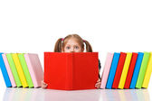 Little girl peeking from pile of books. Isolated — Stock Photo