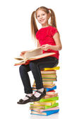 Little girl sitting on stack of books. Isolated. — Stock Photo