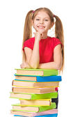 Happy little schoolgirl with a stack of books. Isolated — Stock Photo
