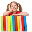 Happy Little girl holding pile of books. Isolated — Foto Stock
