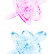 Blue and pink pacifier — Stock Photo