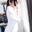 Woman talking on mobile phone at work — Stock Photo #28496133