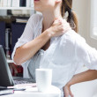 Woman with back pain at work — Stok fotoğraf