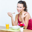 Young woman having breakfast at home — Stock Photo #28753461