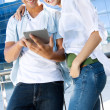 Young couple using a digital tablet — Foto Stock
