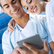Young couple using a digital tablet — Stock Photo #29883235