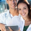 Stock Photo: Young couple using a digital tablet