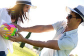 Young couple having fun in a park — Stock Photo
