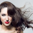 Stock Photo: Photo of beautiful woman with magnificent hair