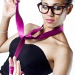 Stock Photo: Black womin evening dress playing with tie