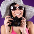 Beautiful woman with bikini holding vintage retro camera — Stock Photo
