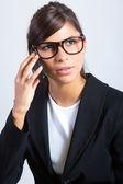 Beautiful brunette businesswoman talking by smartphone — Stock fotografie