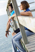 Portrait of young couple looking at the horizon — Stock Photo