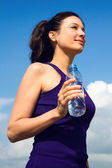 Young Woman drinking water after sport activities — Stock Photo