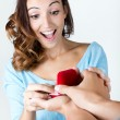 Young womaccepts engagement ring — Stock Photo #32404539