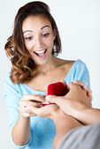 Young woman accepts an engagement ring — Stock Photo