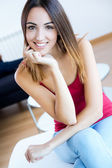 Pretty young woman at home — Stock Photo