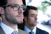 Two young executives arriving at the hotel — Stock Photo
