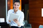 Beautiful modern businesswoman holding tablet computer — Stock Photo