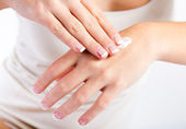 Body care. Woman applying cream on hands — Stock Photo